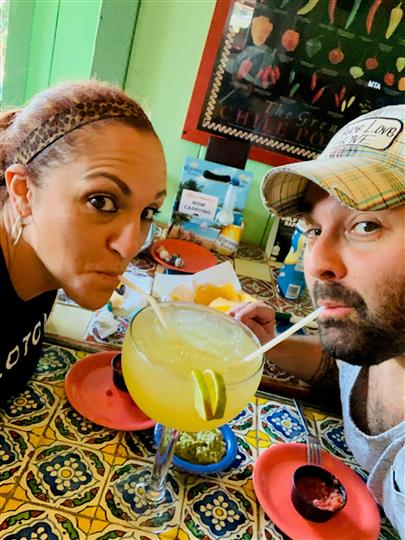 Two adults sharing a margarita