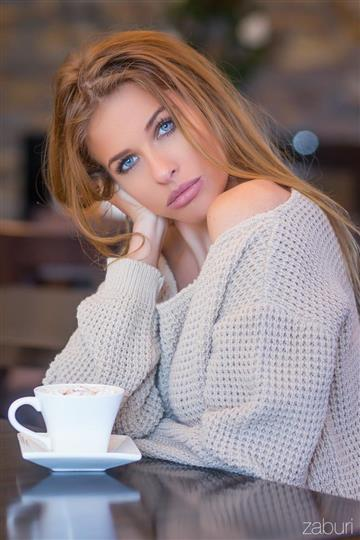 Lady next to coffee cup