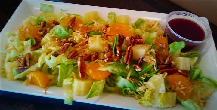 Salad with orange slices and pecans