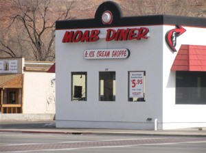 exterior building to moab diner next to a street during the day