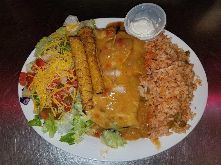 enchilada with a side salad and rice