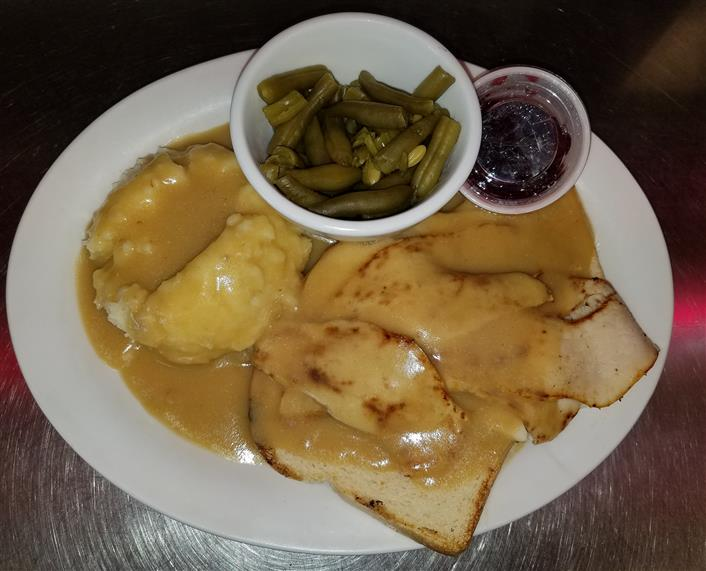 turkey with gravy, mashed potatoes and string beans