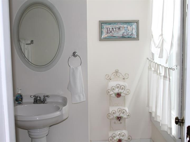 Sink and mirror with a towel rack