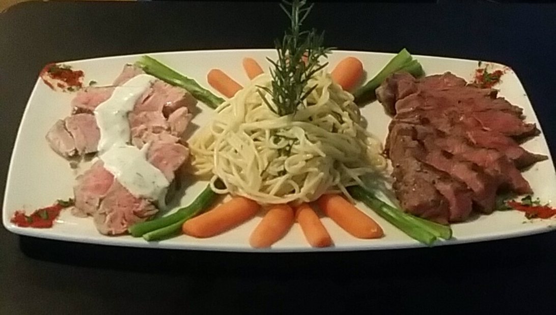 steak and pasta platter with vegetables