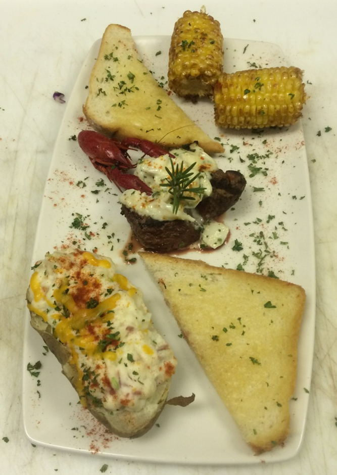 surf and turf entree with corn and bread