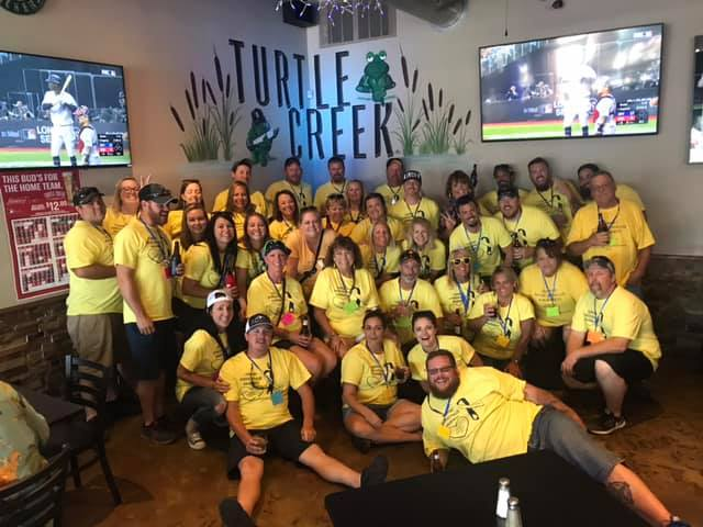 inside turtle creek pub with staff and customers dressed in t shirts for Hydrocephalis Awareness