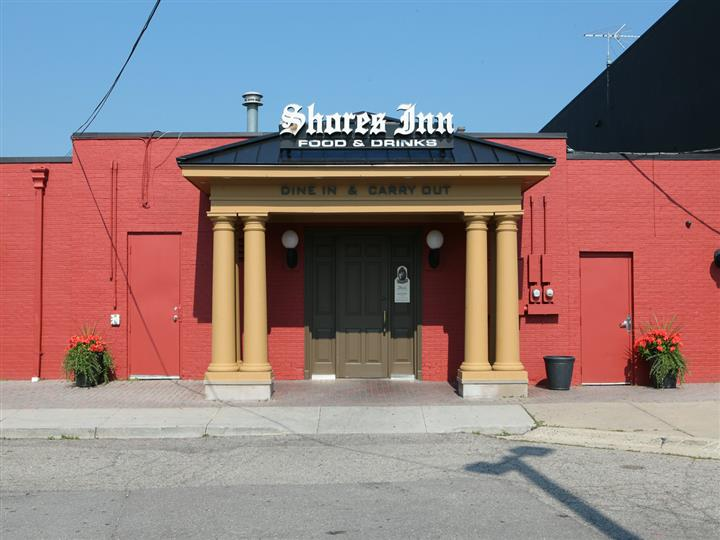 Shores Inn Food & Drink, dine in or carry out sign over entrance