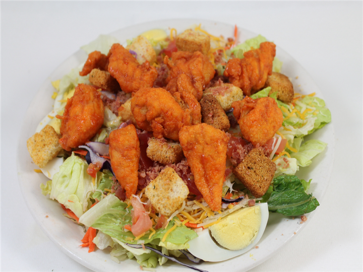 Salad topped with buffalo chicken