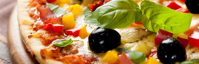 Closeup of pizza with black olives, basil