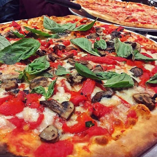 Verdura Pizza. Grated mozzarella, tomato sauce, roasted pepper, basil, portobello mushrooms.