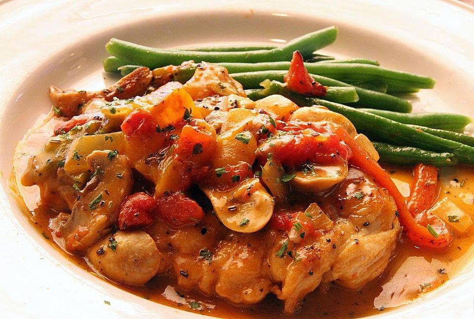 Pollo Cacciatore. Boneless chicken breast in marinara sauce with hot cherry peppers and onions.