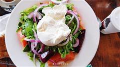 Caprese Salad. Tomato, fresh burrata, roasted pepper, mixed greens, balsamic vinaigrette.