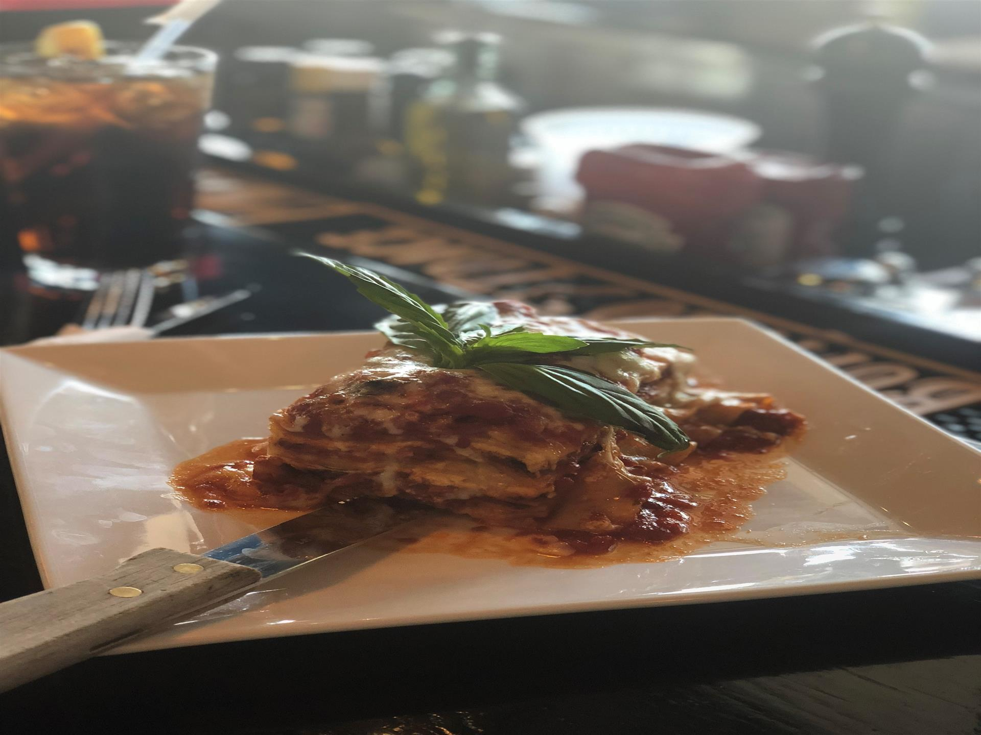 Plated Lasagna slice topped with basil garnish