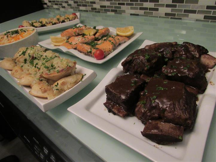 Shot of a buffet section with different sized platters and a variety of appetizers