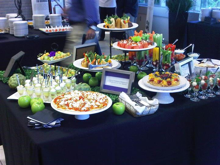 Photo of a buffet table with food stands and snack trays at an event