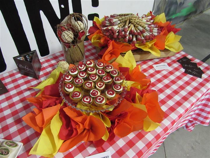 Buffet table with baked goods in a colorful display with colored napkins as decoration