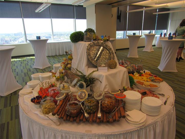 Buffet table all set for service in the middle of a conference room