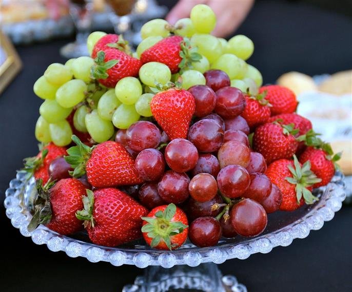 grapes and strawberries on a tray