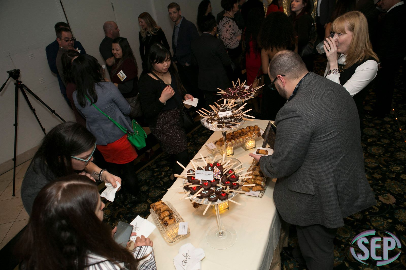 guests grabbing dessert from a table