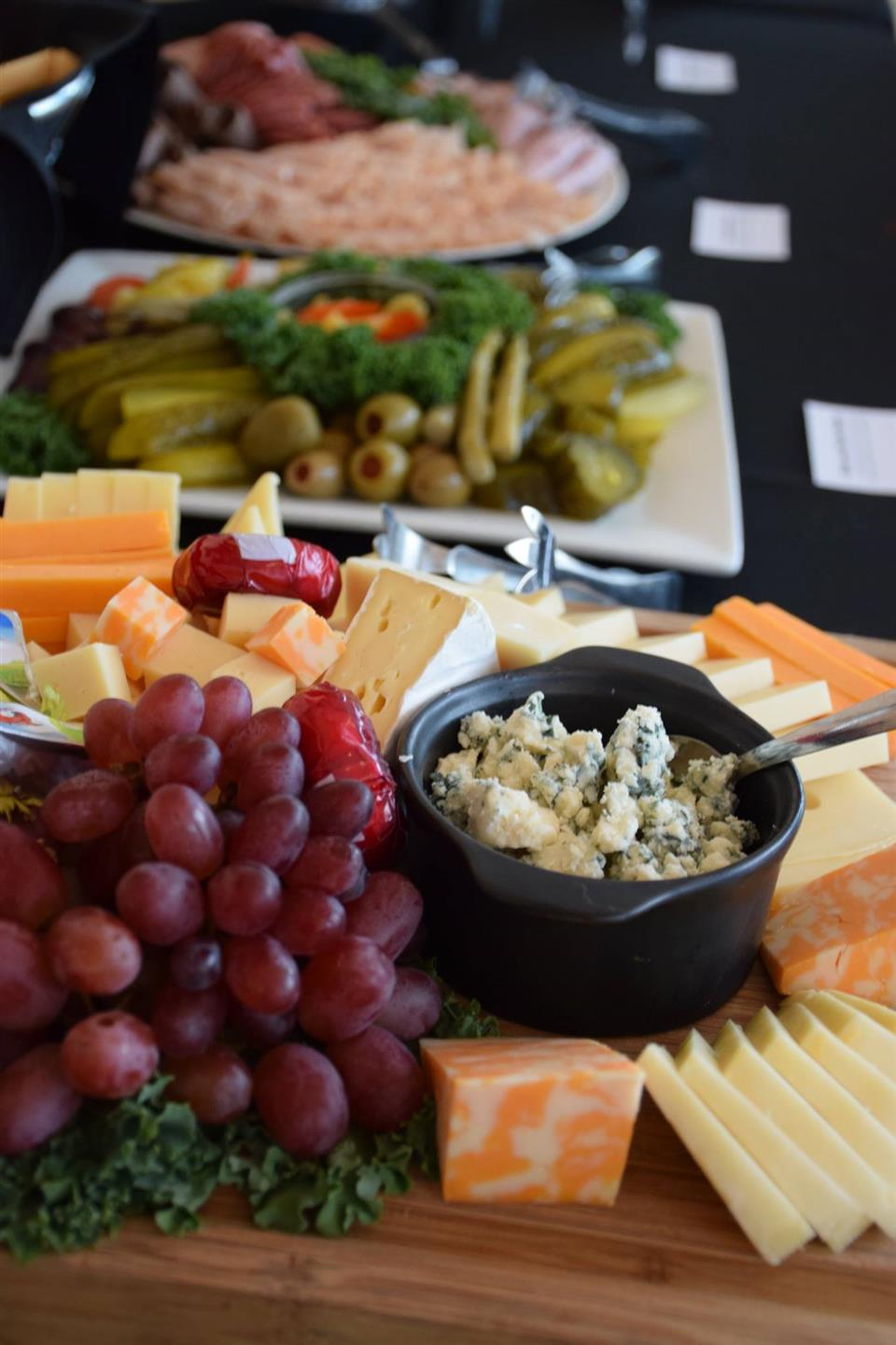 board with sliced cheese and grapes