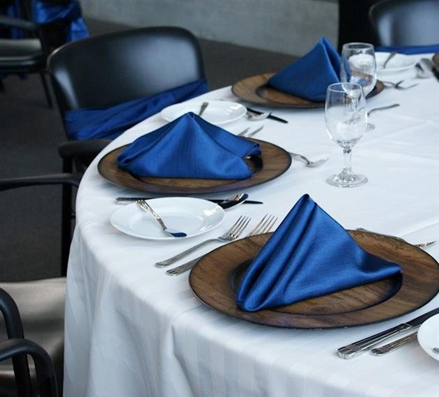 table set with glassware and napkins