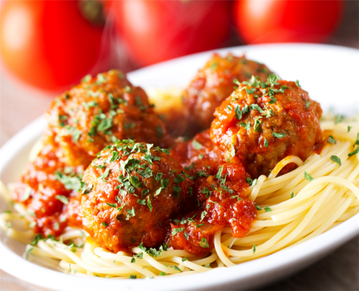 Spaghetti with meatballs with sauce on a plate
