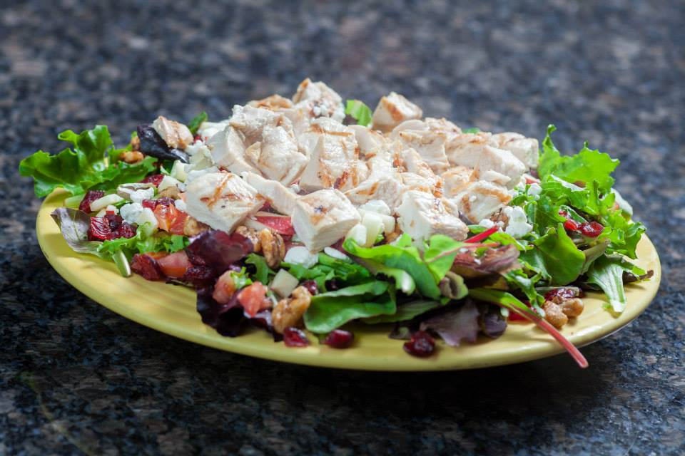 Grilled chicken salad with feta and dried cranberries