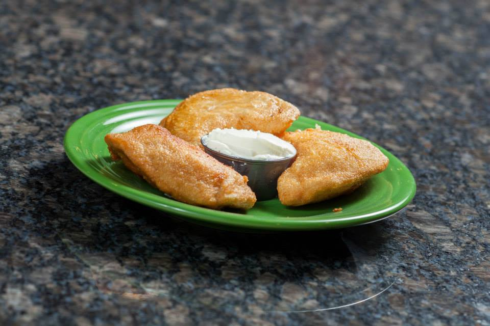 Mini empenadas with sour cream