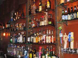 bar area with many liquor bottles shown