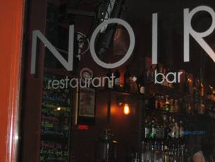 "glass door that says ""Noir restaurant and bar"""