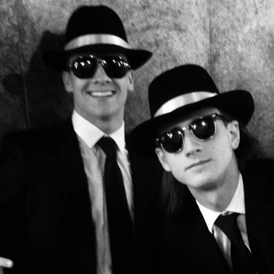 two customers dressed as the characters from men in black