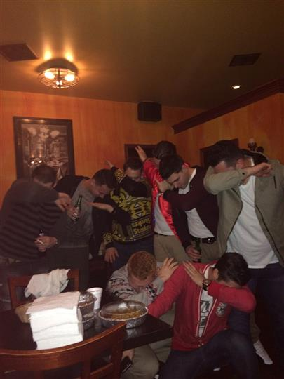 a group of guys dabbing