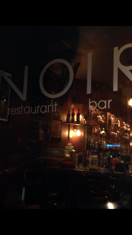 "the front door which says ""Noir restaurant and bar"""
