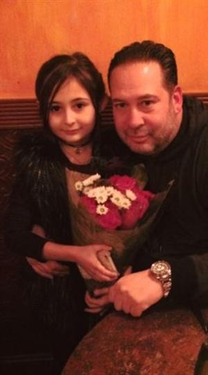 a dad and his daughter holding a bouquet