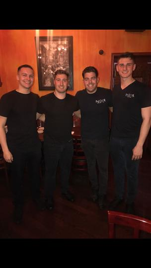 four servers posing together