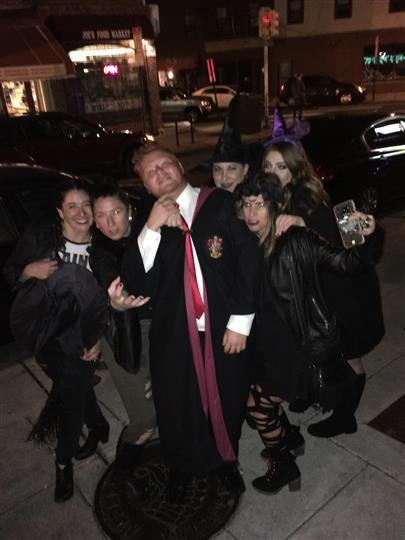 six customers posing outside the restaurant and dressed up for halloween