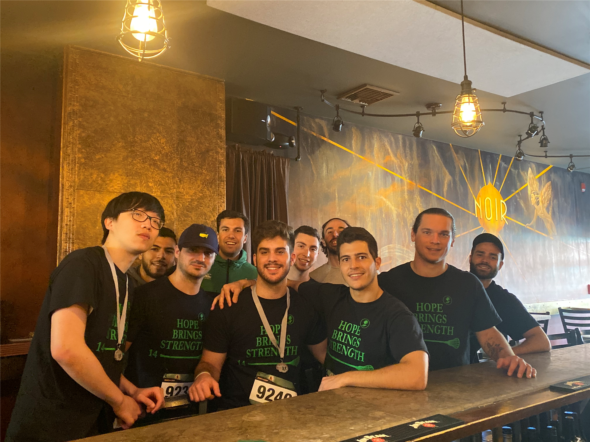 Group of Employees in front of Bar