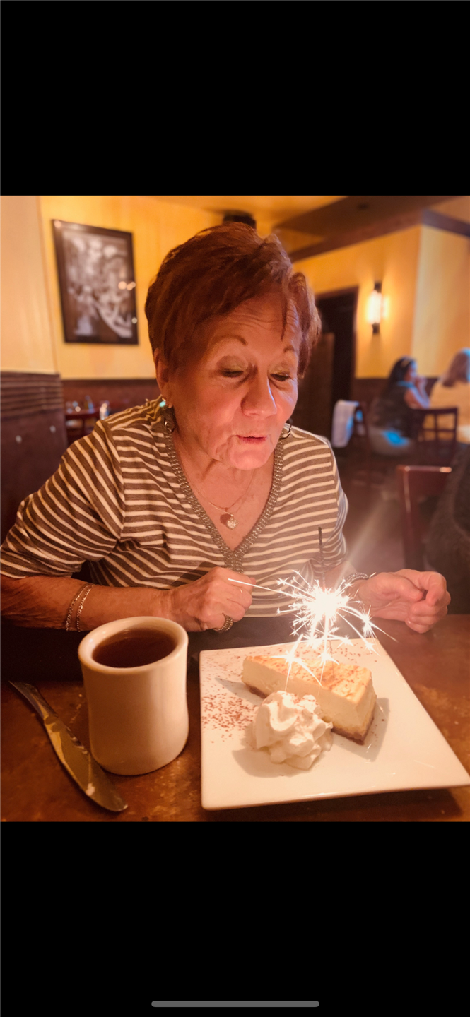 woman blowing out a candle