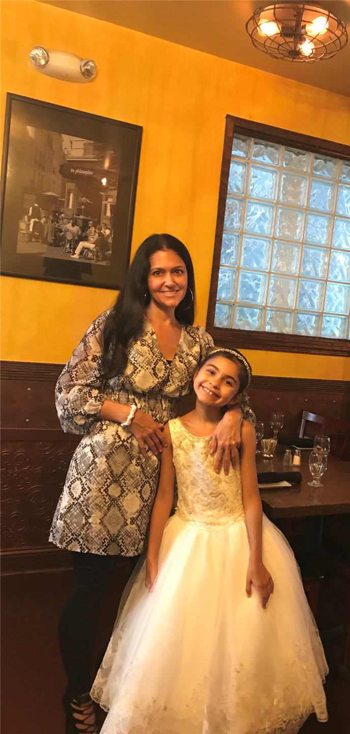 smiling mother with daughter in dress