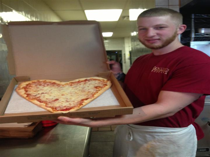 Heart shapped cheese pizza pie