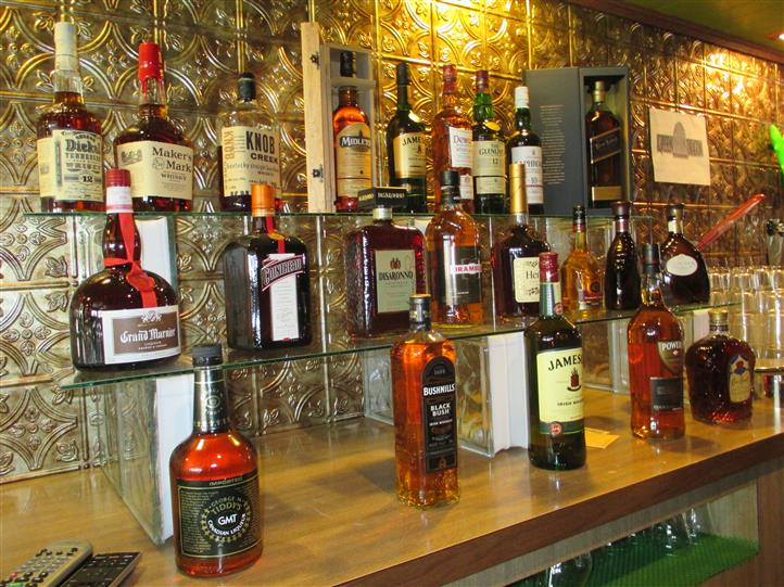 various liquor bottles being displayed behind the counter
