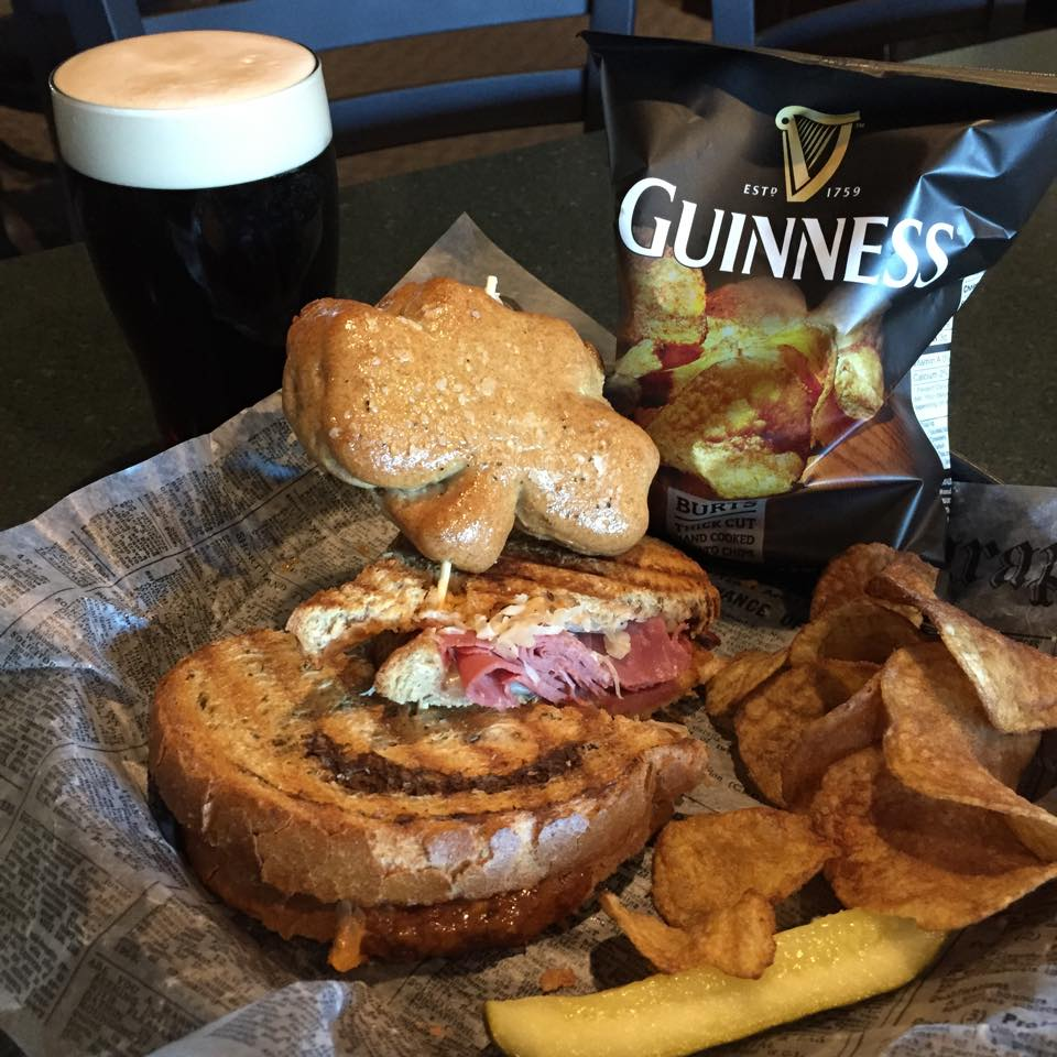 sandwich with a side of guinness chips and guinness pint