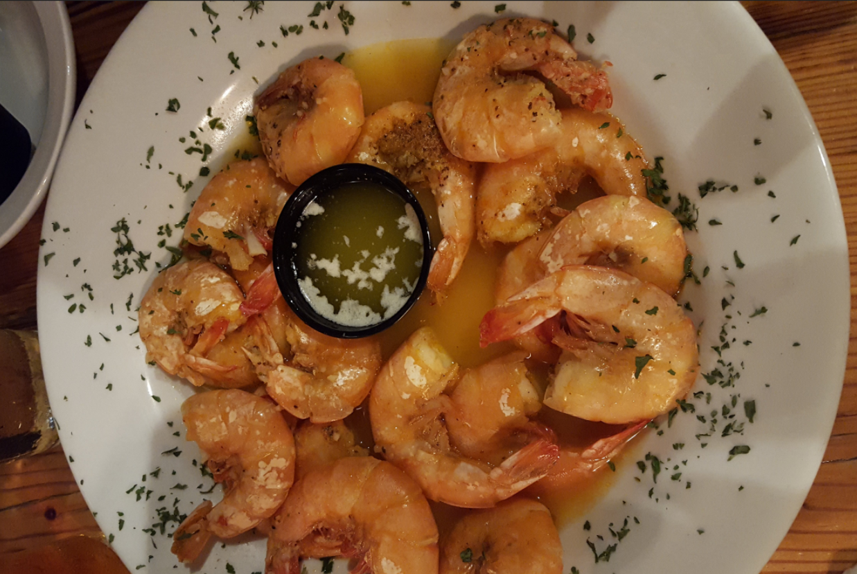 Shrimp in a bowl with butter sauce