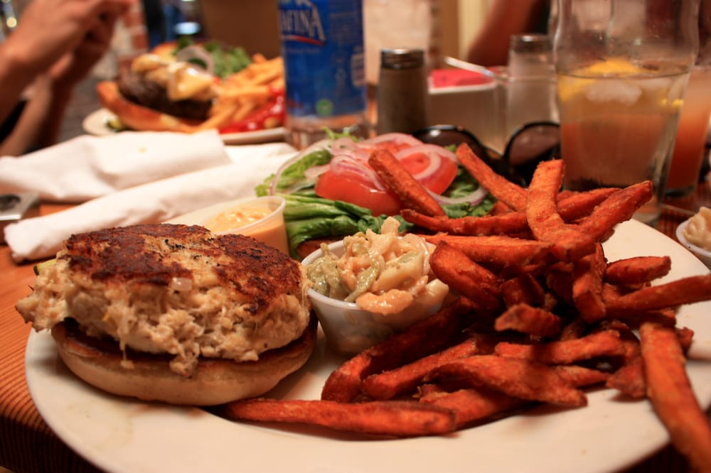 Fish alongside sweet potato fries