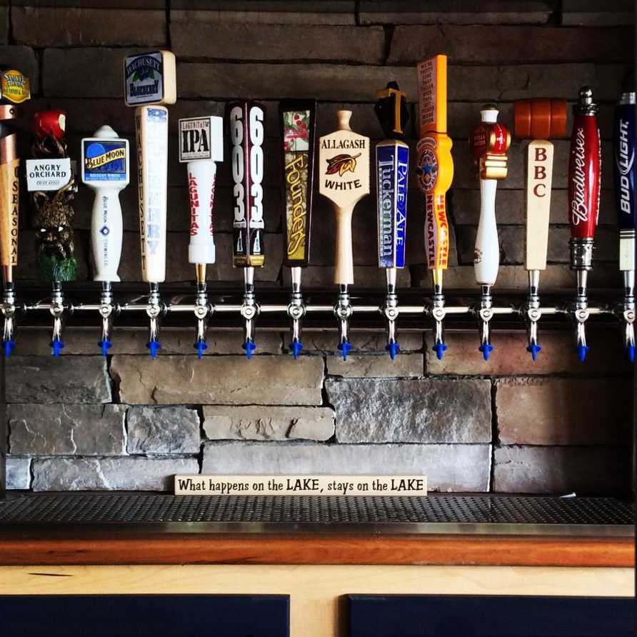 Assorted beer taps on a rail