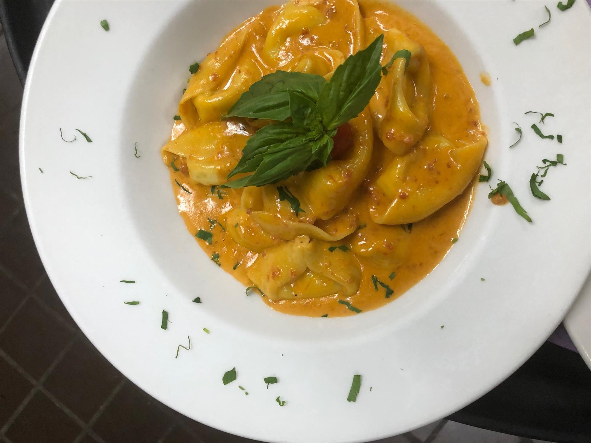 pasta in sauce topped with basil