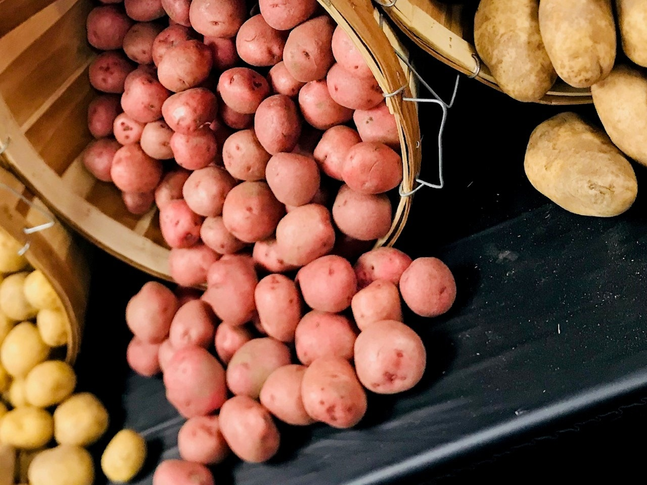 Assortment of potatoes in a barrel