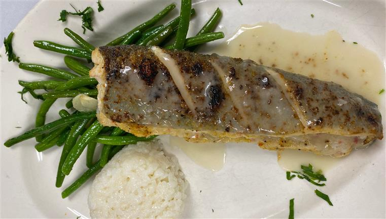 Rainbow trout. Broiled stuffed rainbow trout with fresh crab meat in creamy dill sauce, served with string beans and porcini mushrooms risotto.