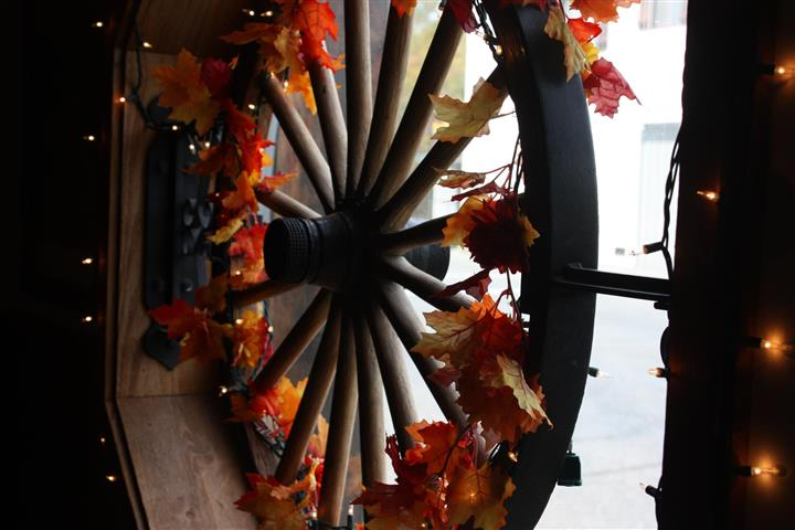 Decorative wheel covered in autumn leaves