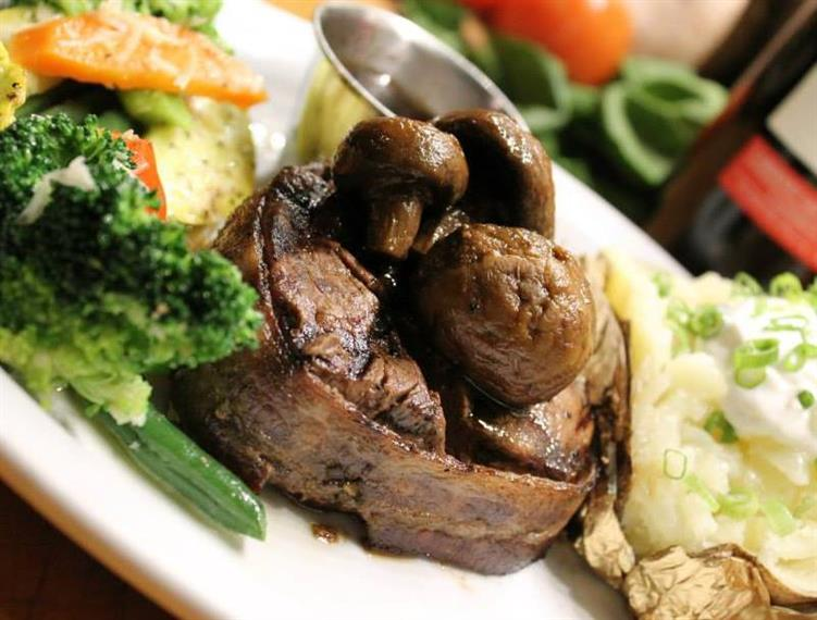 Steak dish served with sauteed vegetables